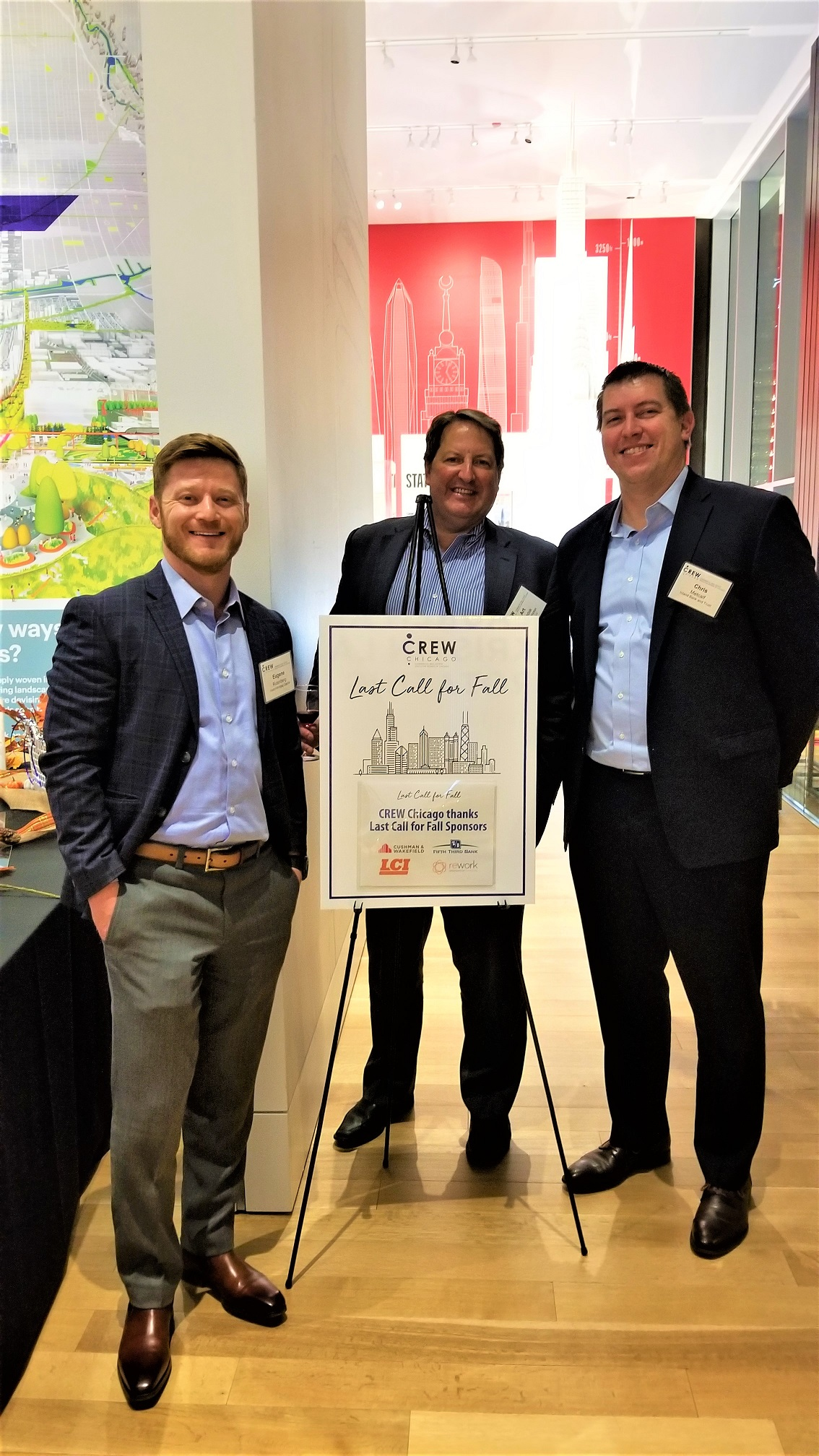 Art Rendak and Eugene Rutenberg networked at CREW Chicago's 2019 Last Call for Fall event, held at the Chicago Architectural Center. Pictured also, is Chris Metcalf of Inland Bank.